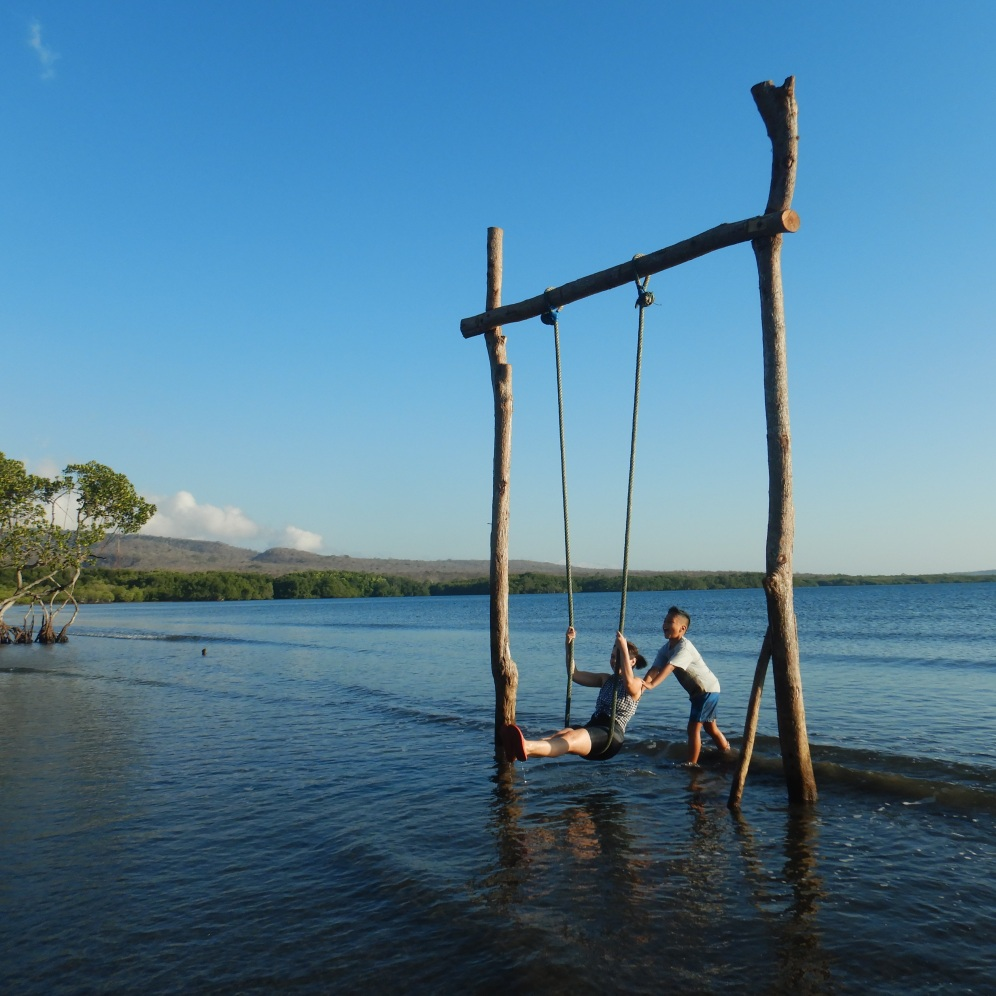 Swinging at Teluk Terima Beach